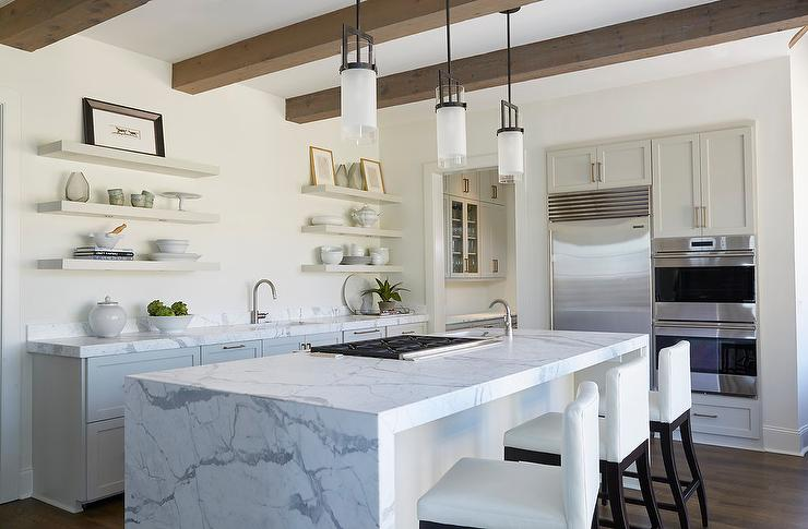 Marble Waterfall Island With White Leather Barstools
