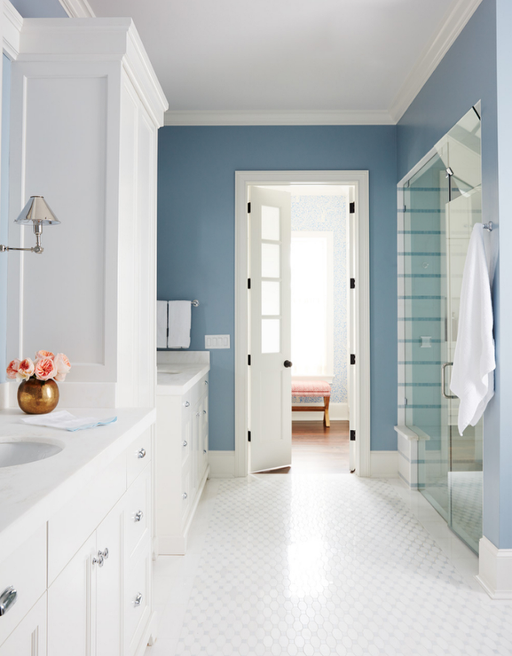 White And Blue Master Bathroom With Bifold Closet Doors