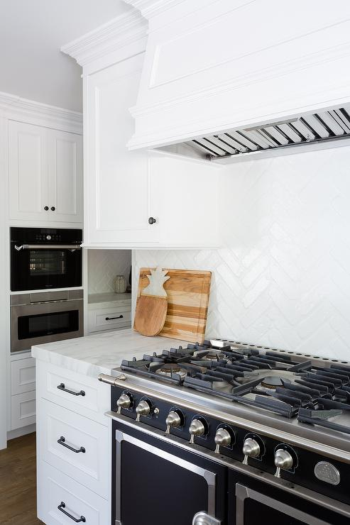 White Vent Hood With Black Range Transitional Kitchen