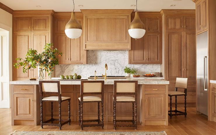 Honey Stained Oak Kitchen Cabinets with Brass Pendants ...