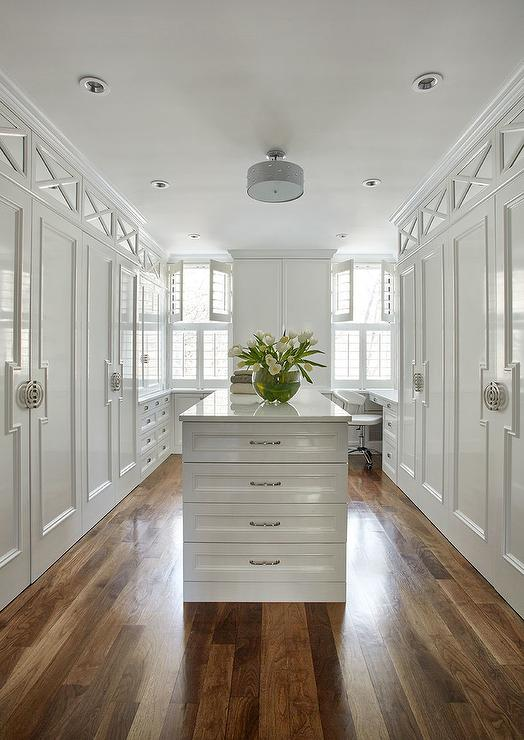 Glamorous Large White Walk In Closet Fitted With A Semi Flush Mount Fixed Above Center Island Accented Drawers Donning Polished Nickel