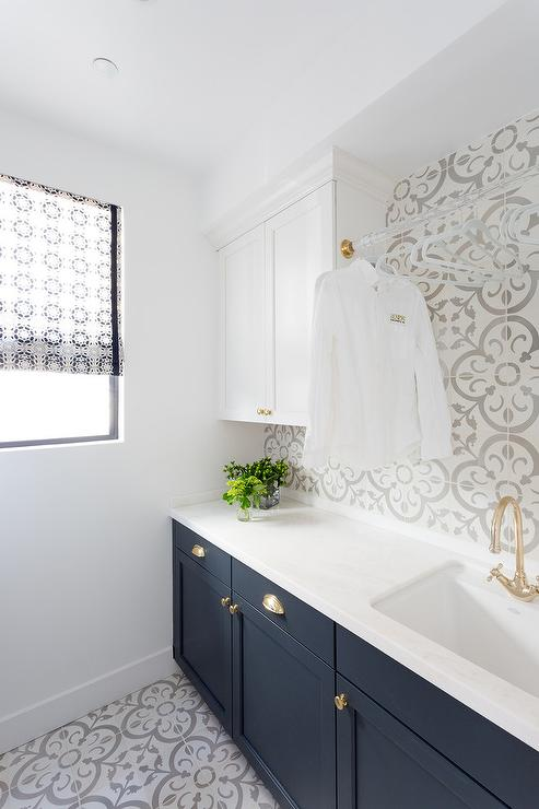 White Upper Laundry Cabinets And Dark Blue Lower Laundry Cabinets