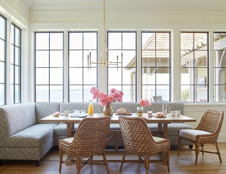 Chic Breakfast Nook Is Filled With A Gray Diamond Print Freestanding Sofa  Bench Tucked Under Windows, Facing A Light Wood Trestle Dining Table Lined  With ...