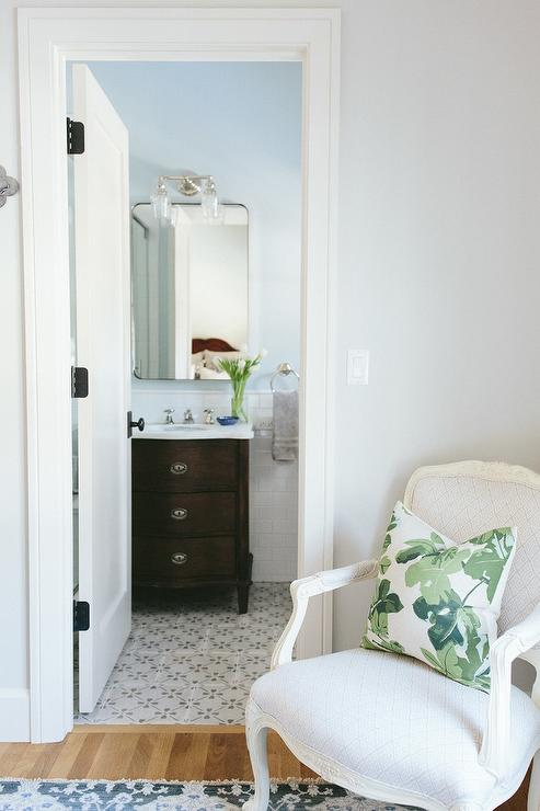 Hand Carved Bath Vanity With White Subway Tiles