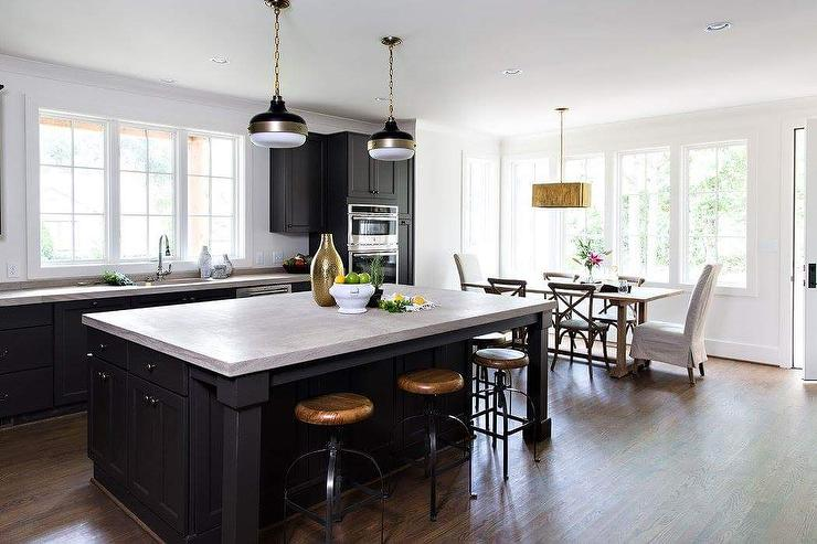 black kitchen island with gray countertops