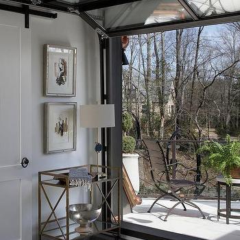 Glass Garage Style Door Opens To Patio