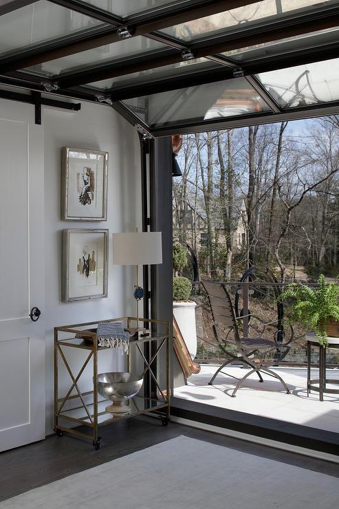 Glass Garage Style Door Opens to Patio - Eclectic - Deck/patio