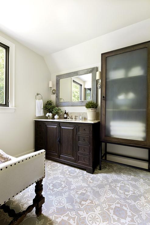 ... Mosaic Cement Tile Floor Facing A Dark Brown Single Washstand Tucked  Under A Gray Mirror Placed Next To A Freestanding Linen Cabinet With  Frosted Glass ...