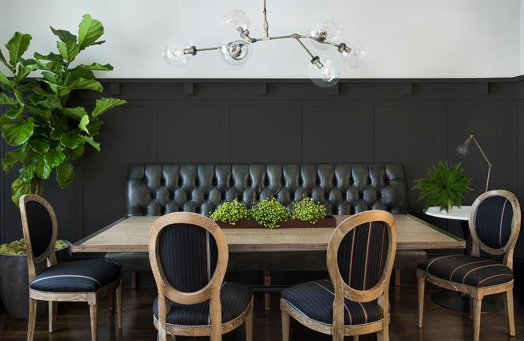 Superieur A Black Board And Batten Wall Is Lined With Black Leather Tufted Dining  Bench Facing A Salvaged Wood Dining Table With Metal Trim Lined With Round  Back ...