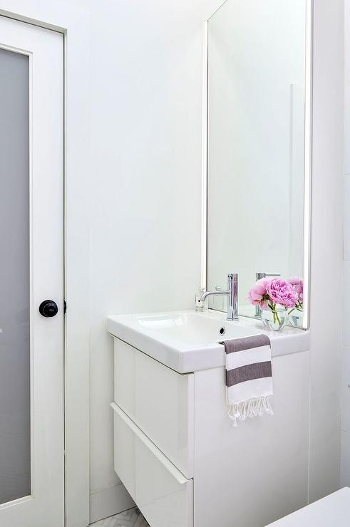 Floating vanity contemporary bathroom house beautiful - Bathroom vanity with frosted glass doors ...