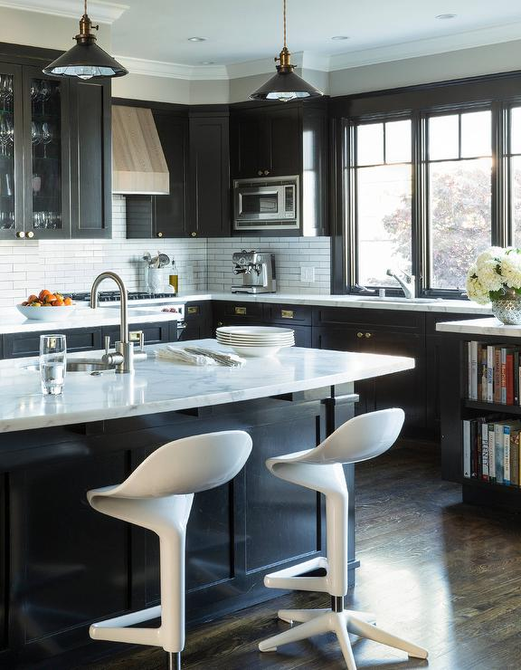 Black Kitchen Cabinets With Textures Wood Vent Hood