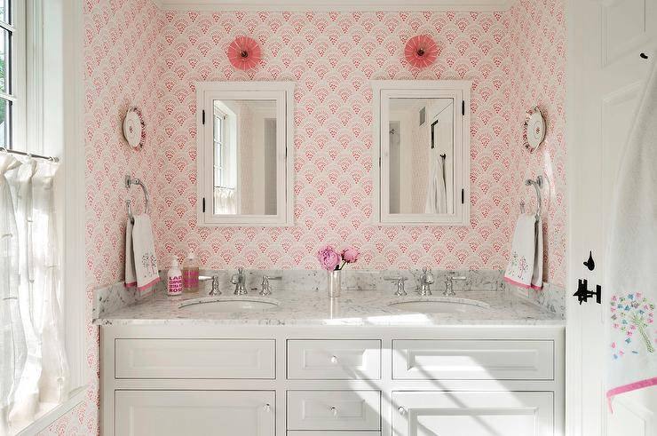 White And Pink Bathroom Features A Dual Washstand Fitted With Two Oval Sinks Polished Nickel Vintage Faucets Tucked Under Framed