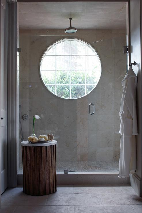 Spa Like Shower Features Marble Tiles On Wall Fitted With A Large Round  Window.