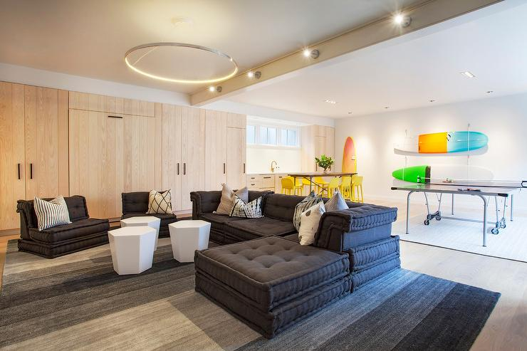 Basement Lounge With Black Tufted Sectional Contemporary
