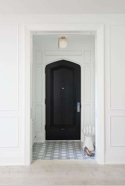 Vestibule With Black Moorish Style Front Door