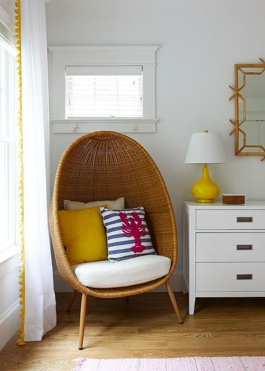 Wicker Pod Chair With Yellow And Blue Pillow