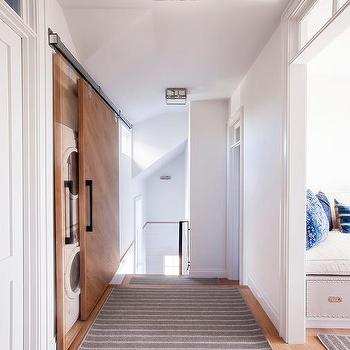 Hallway Laundry Room With Sliding Door On Rails