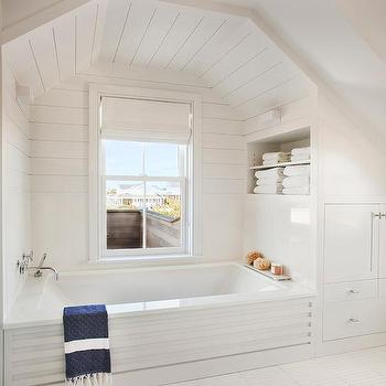 White And Blue Bathroom With Arched Tub Alcove
