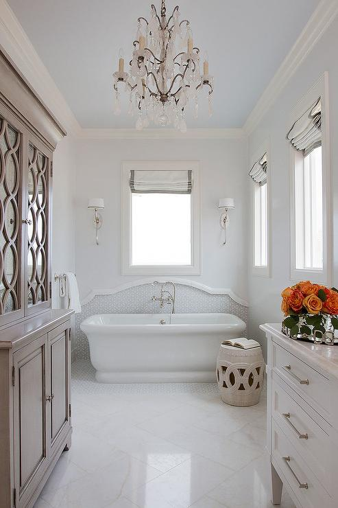 Empire freestanding bathtub under window covered in gray for Empire bathrooms