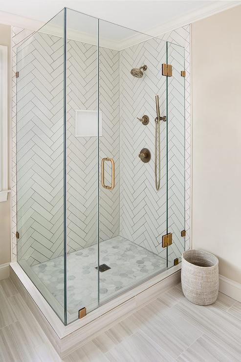 Shower With White Herringbone Tiles And Gray Grout