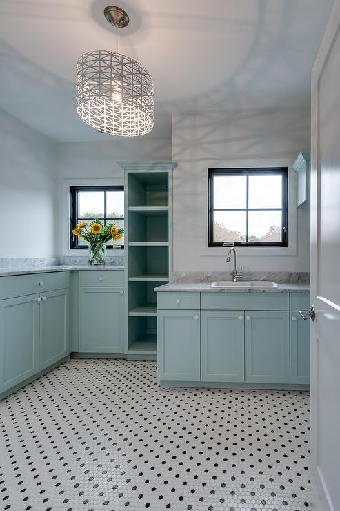 Turquoise Blue Laundry Room With Gray Marble Countertops
