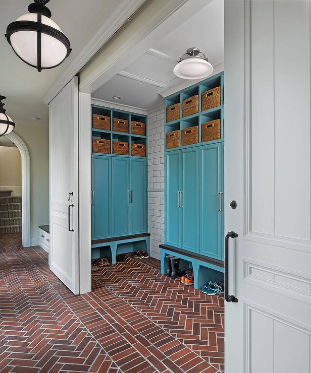Blue Mudroom Locker Cabinets With Red Brick Herringbone