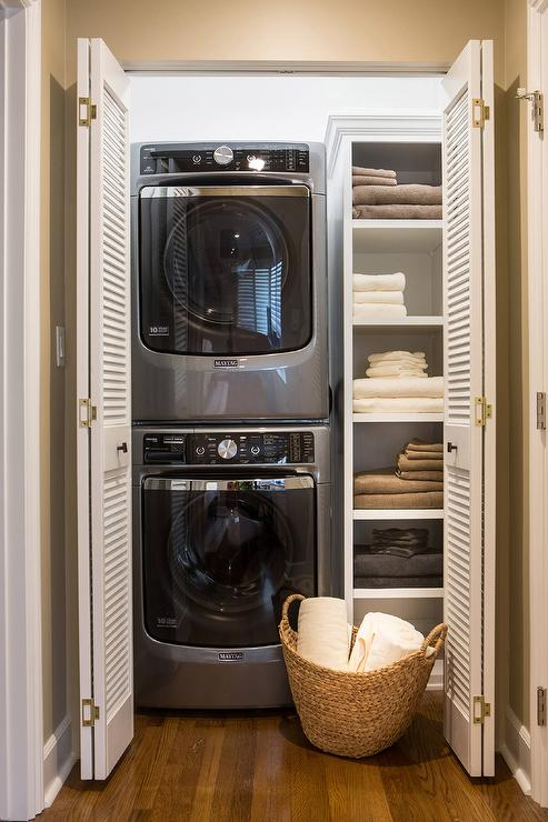 Superbe A Maytag Washer And Dryer Is Stacked In This Organized Closet With Folding  Louvered Doors.