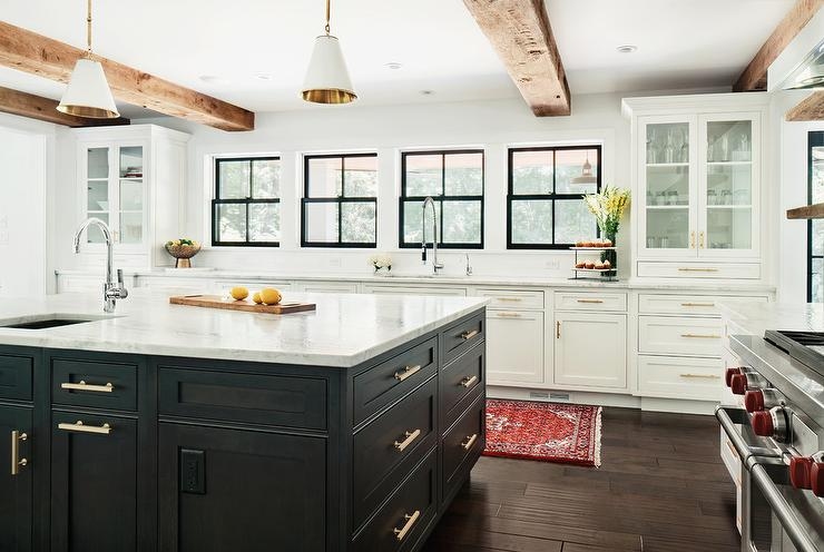 White And Gray Kitchen With Stained Wood Ceiling Beams