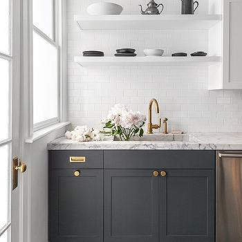 White Floating Shelves Over Dark Gray Cabinets