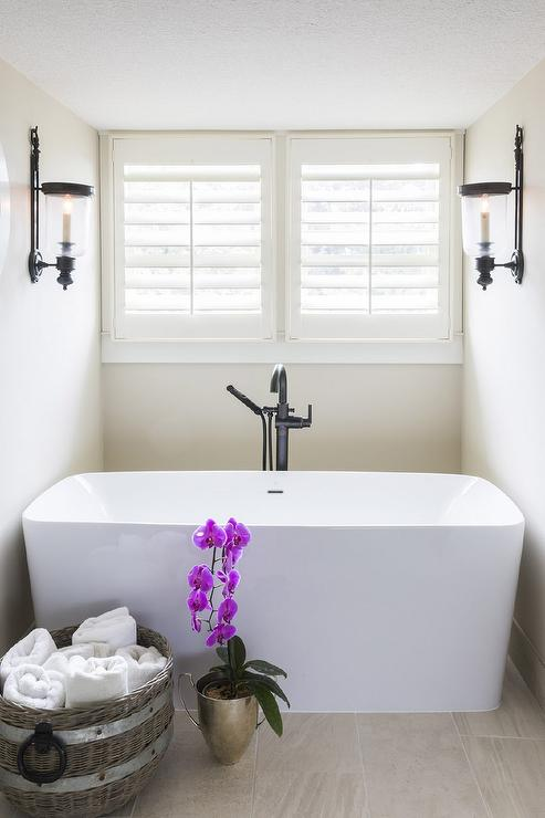 oil rubbed bronze freestanding tub filler. white and tan zen bathroom boasts a nook filled with rectangular freestanding bathtub paired an oil-rubbed bronze gooseneck tub filler tucked under oil rubbed f