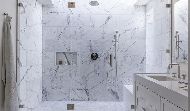 White Shower Tiles With Gray Shower Bench Transitional