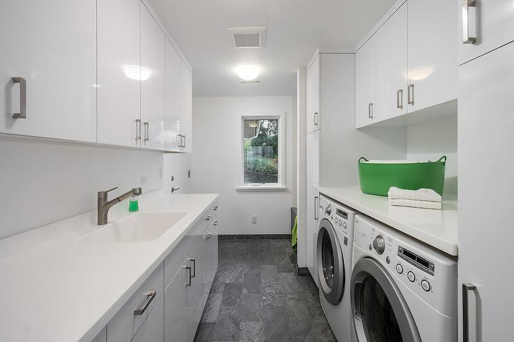 White And Gray Laundry Room With Green Accents