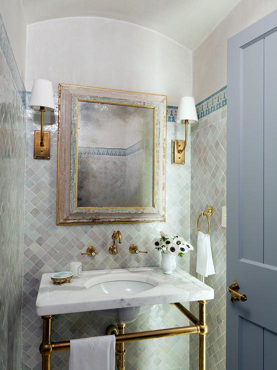 powder room wall tile designs. under a moroccan barrel ceiling, this mediterranean powder room is illuminated by hulton sconces mounted to gray diamond pattern wall tiles lined with blue tile designs l