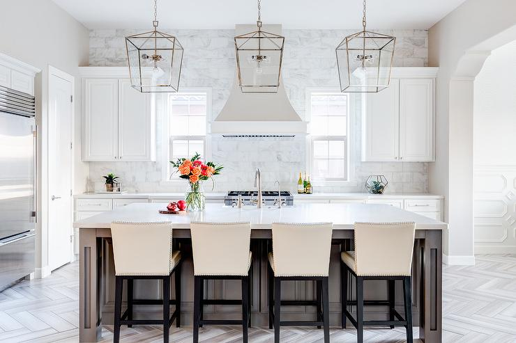 Three Darlana Medium Lanterns Make A Statement In White Transitional Kitchen Boasting Multiple Patterns And Dimension J Design Group