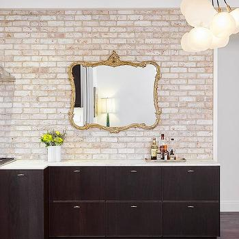 Brown Flat Front Kitchen Cabinets With Whitewashed Brick Backsplash