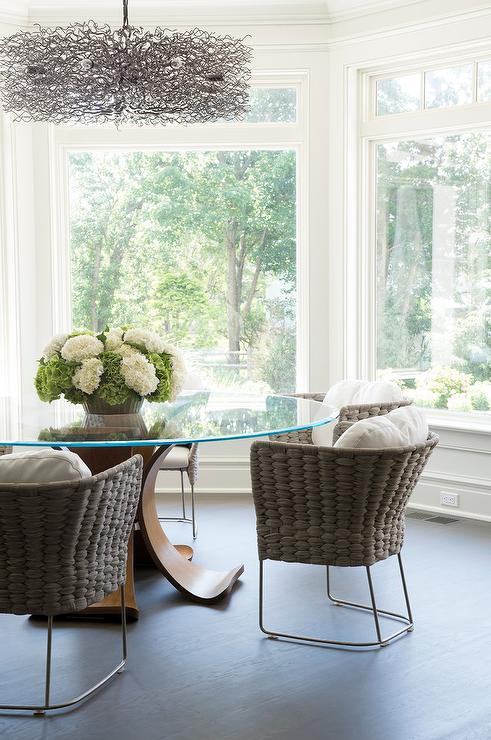 natural light supplies a beautiful breakfast nook with its large frame windows peter cadoux architects beaded chandelier over salvaged wood dining table