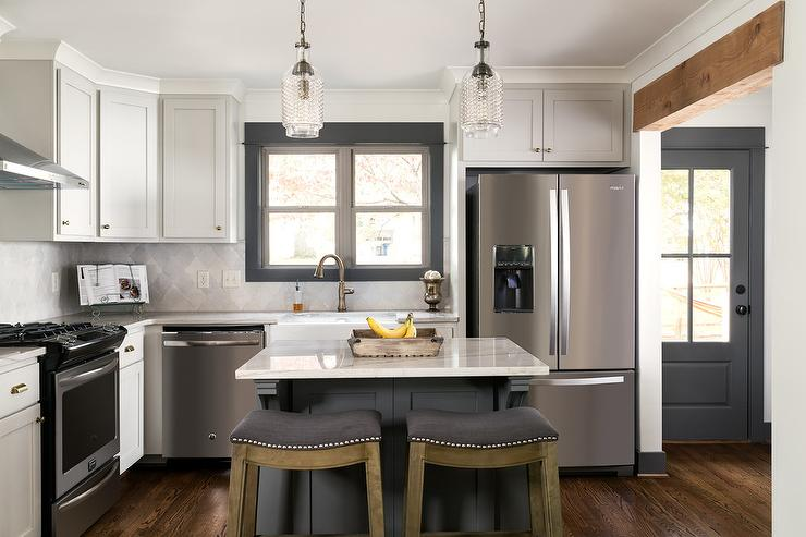 Light gray cabinets with dark gray kitchen island for Dark kitchen cabinets light island