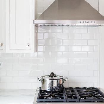 White Kitchen Cabinets With All White Subway Tiles