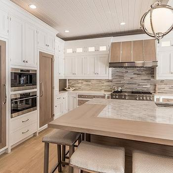 White and gray kitchen with stained wood ceiling beams - Kitchen island decorative trim ...