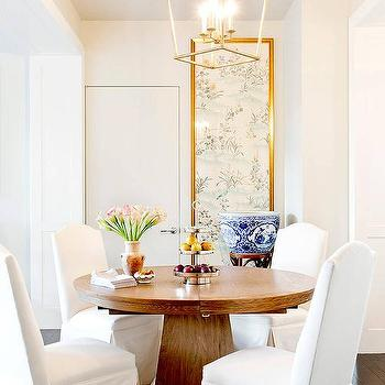 Round Pedestal Dining Table With White Slipcovered Camelback Chairs