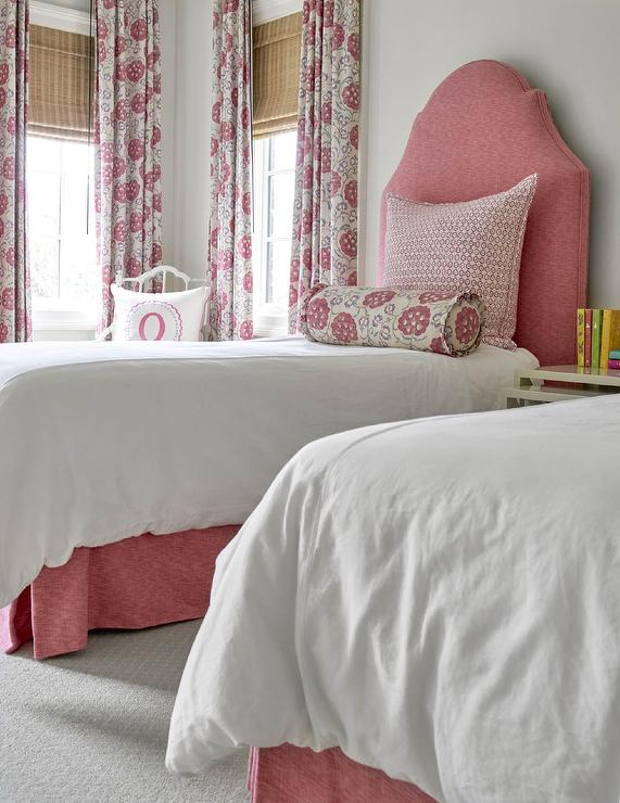 pink and gray shared girlu0027s room features two beds dressed in white bedding topped with a red floral bolster pillows and white and pink shams placed against