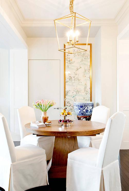 Round Pedestal Dining Table With White Slipcovered Camelback Chairs Transitional Dining Room