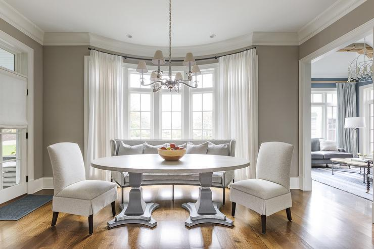 Oval Pedestal Dining Table In Bay Window Transitional