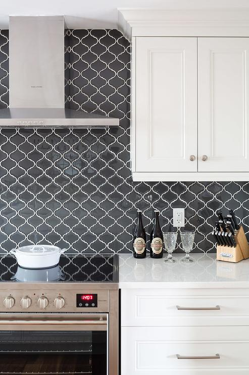 Off White Cabinets With Black Arabesque Tiles Transitional Kitchen