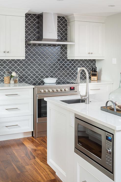 Off White Kitchen Cabinets With Black Backsplash Tiles
