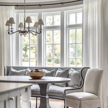 Curved Gray Dining Settee In Bay Window