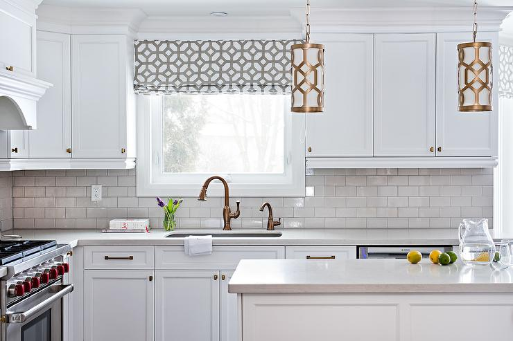 white kitchen with copper gooseneck faucet