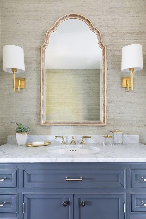 Blue Washstand With Gold Sconces Transitional Bathroom