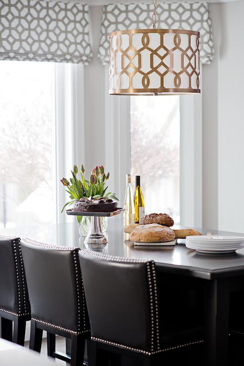 Black Island Dining Table With Gold Trellis Drum Pendant