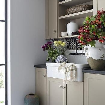 Cream And Blue Laundry Room With Brown Tiles